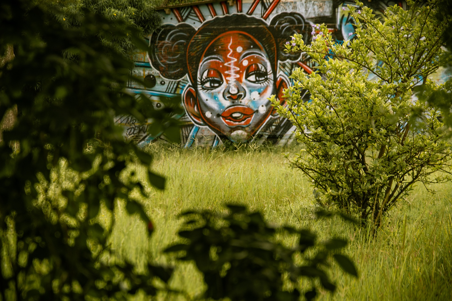 Young people in Nairobi graffiti of a girl
