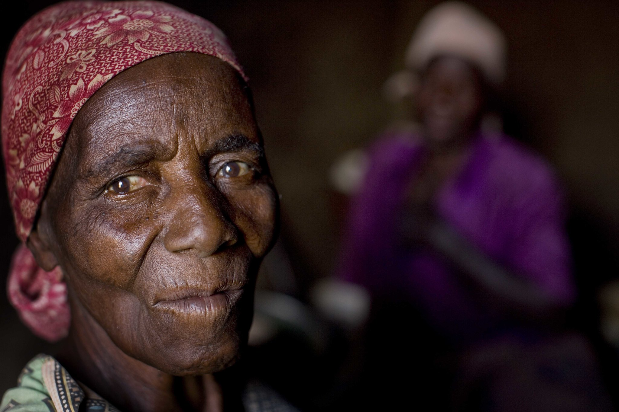 """""""Violet Gavin, 69 years old, sits in her small hut with her daughter,, who is disabled and lives at home, near Chimteka, Malawe on the 15th April, 2009."""" Social protection should be inclusive of persons with disabilities"""