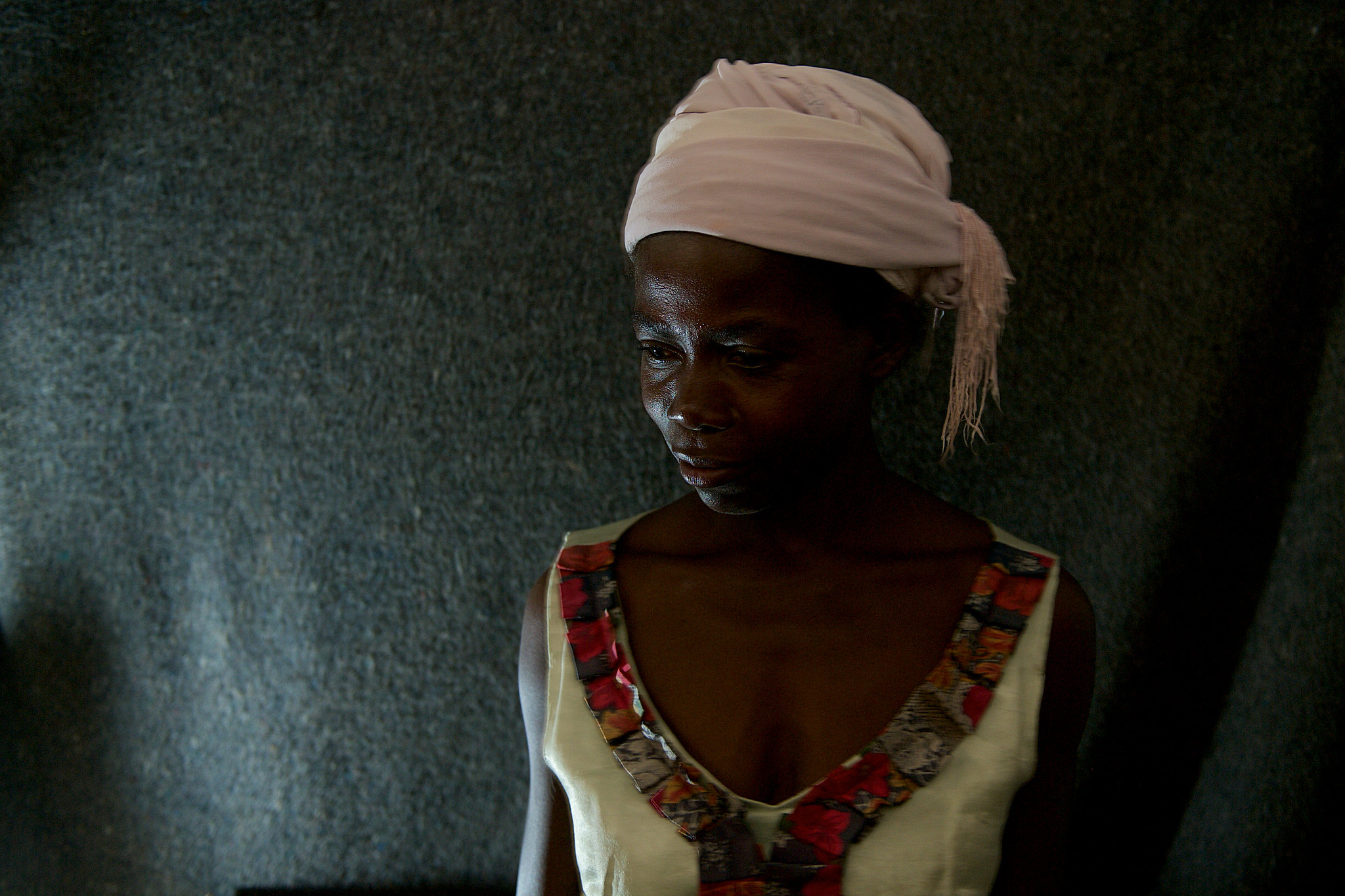 A portrait of a woman from DRC who has received support after fleeing gender based violence